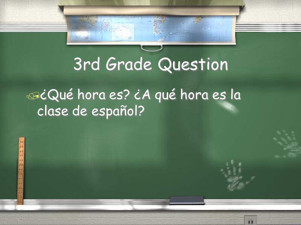 4th Grade Answer / El reloj está arriba de la pizarra y a la izquierda del escritorio. Return
