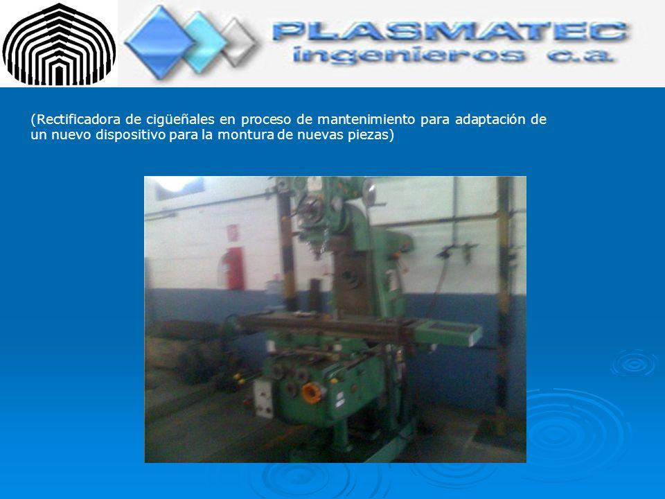 (Rectificadora de cigüeñales en proceso de mantenimiento para adaptación de un nuevo dispositivo para la montura de nuevas piezas)