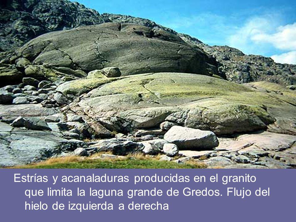 Estrías y acanaladuras producidas en el granito que limita la laguna grande de Gredos. Flujo del hielo de izquierda a derecha