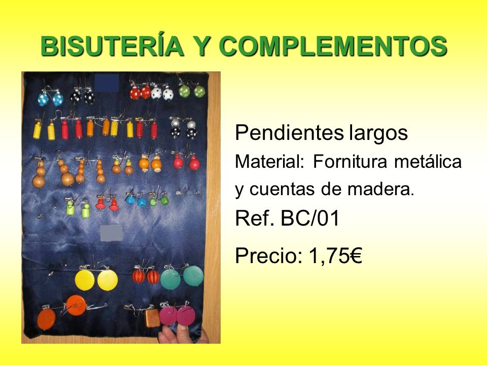 BISUTERÍA Y COMPLEMENTOS Pendientes largos Material: Fornitura metálica y cuentas de madera. Ref. BC/01 Precio: 1,75