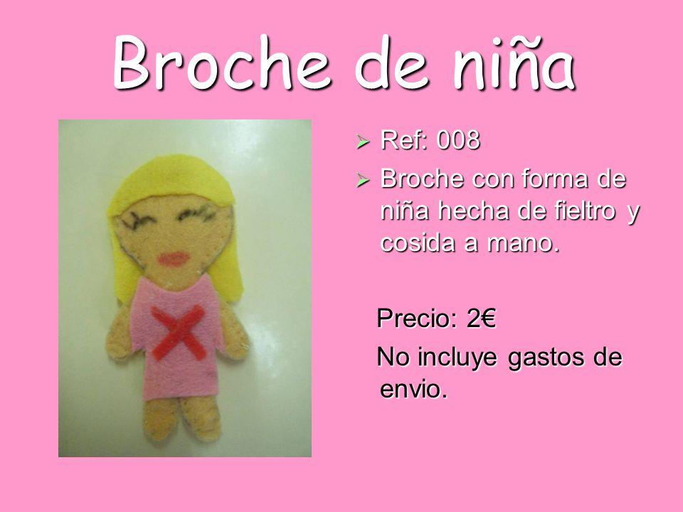 Broche de niña Ref: 008 Ref: 008 Broche con forma de niña hecha de fieltro y cosida a mano. Broche con forma de niña hecha de fieltro y cosida a mano.