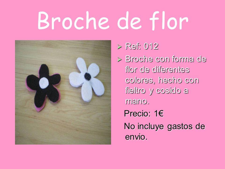 Broche de flor Ref: 012 Ref: 012 Broche con forma de flor de diferentes colores, hecho con fieltro y cosido a mano. Broche con forma de flor de difere