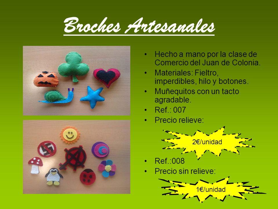 Broches Artesanales Hecho a mano por la clase de Comercio del Juan de Colonia. Materiales: Fieltro, imperdibles, hilo y botones. Muñequitos con un tac