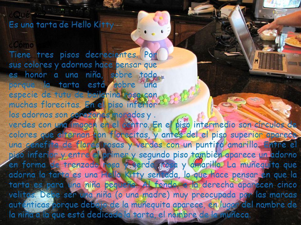 ¿Qué es? Es una tarta de Hello Kitty ¿Cómo es? Tiene tres pisos decrecientes. Por sus colores y adornos hace pensar que es honor a una niña, sobre tod