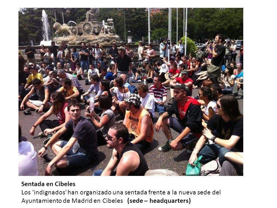 Sentada en Cibeles Los indignados han organizado una sentada frente a la nueva sede del Ayuntamiento de Madrid en Cibeles (sede – headquarters)