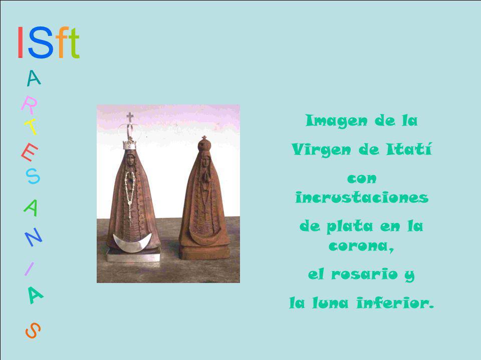 ISftISft A R T E S A N I A S Imagen de la Virgen de Itatí con incrustaciones de plata en la corona, el rosario y la luna inferior.