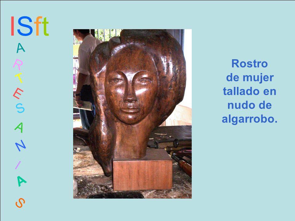 ISftISft A R T E S A N I A S Rostro de mujer tallado en nudo de algarrobo.