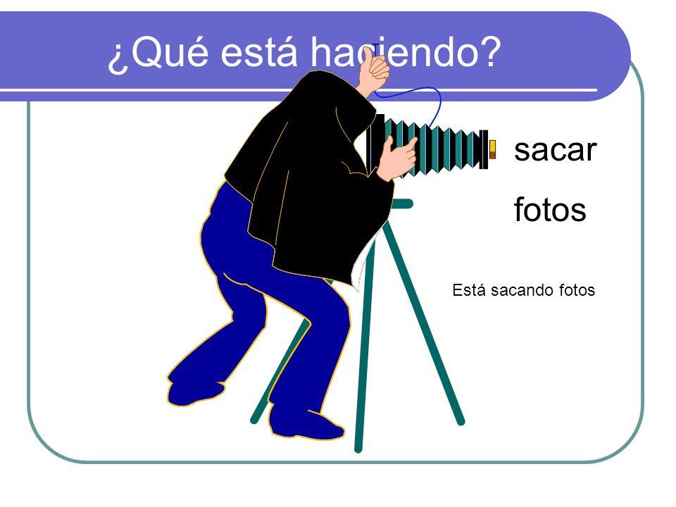 ¿Qué está haciendo sacar fotos Está sacando fotos