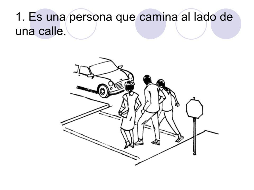 1. Es una persona que camina al lado de una calle.