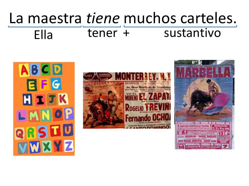 La maestra tiene muchos carteles. tener Ella + sustantivo