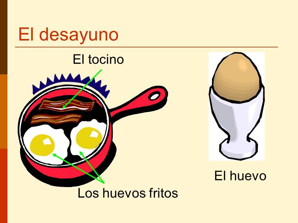 El desayuno Los huevos fritos El huevo El tocino