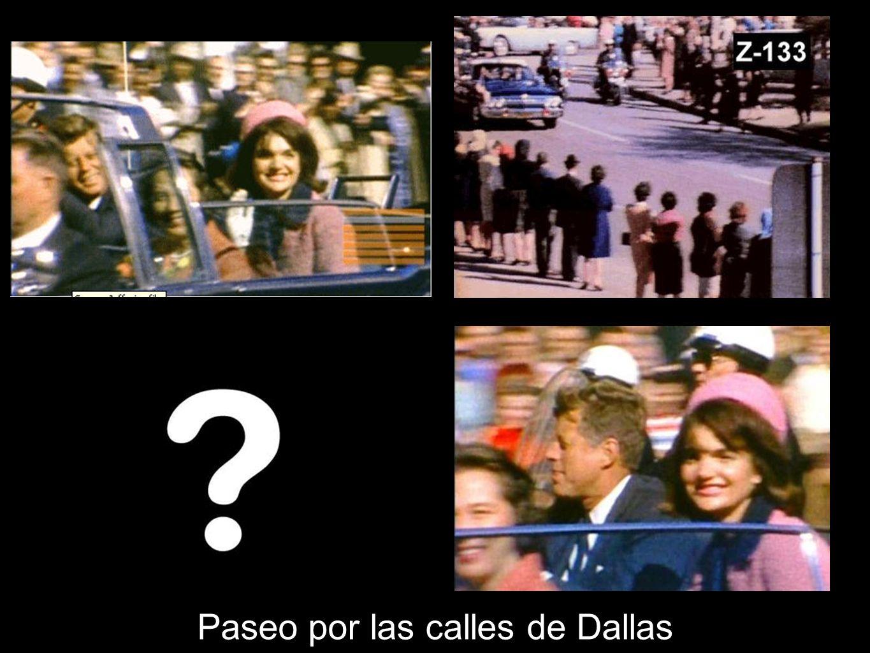 JFK y mujer miran a la derecha (A), la niña Rosemary Willis, deja de correr (B), se ha oído algo ¿Por qué un paraguas abierto en un día soleado.