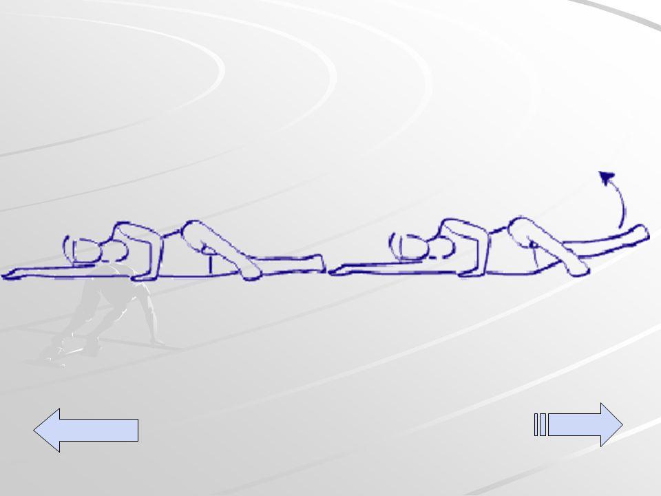 Acostada de costado con el pie superior apoyado en el piso a la altura de la rodilla.