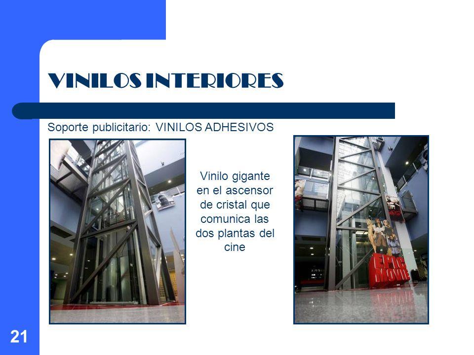 21 VINILOS INTERIORES Vinilo gigante en el ascensor de cristal que comunica las dos plantas del cine Soporte publicitario: VINILOS ADHESIVOS