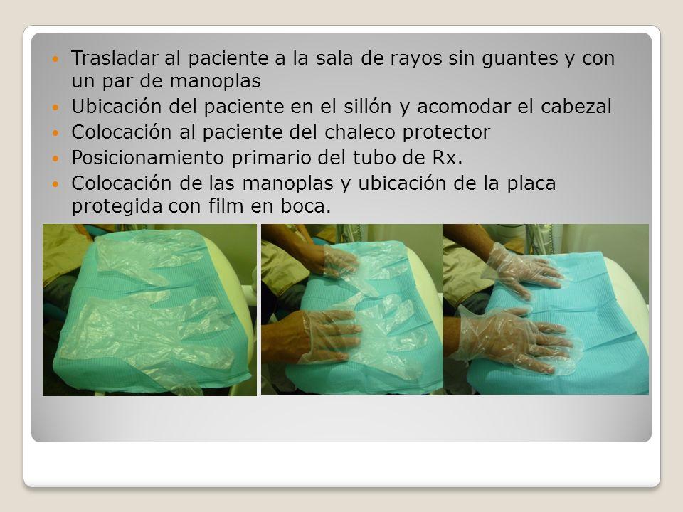 Trasladar al paciente a la sala de rayos sin guantes y con un par de manoplas Ubicación del paciente en el sillón y acomodar el cabezal Colocación al