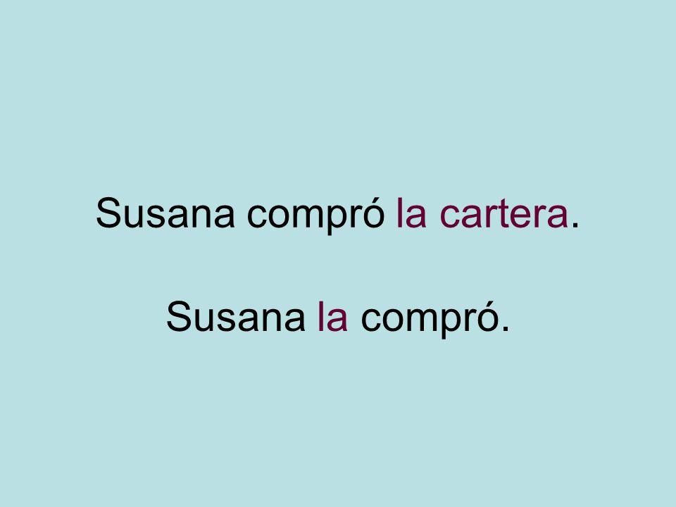 Susana compró la cartera. Susana la compró.