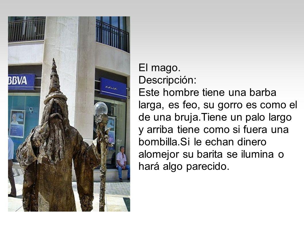 El mago. Descripción: Este hombre tiene una barba larga, es feo, su gorro es como el de una bruja.Tiene un palo largo y arriba tiene como si fuera una