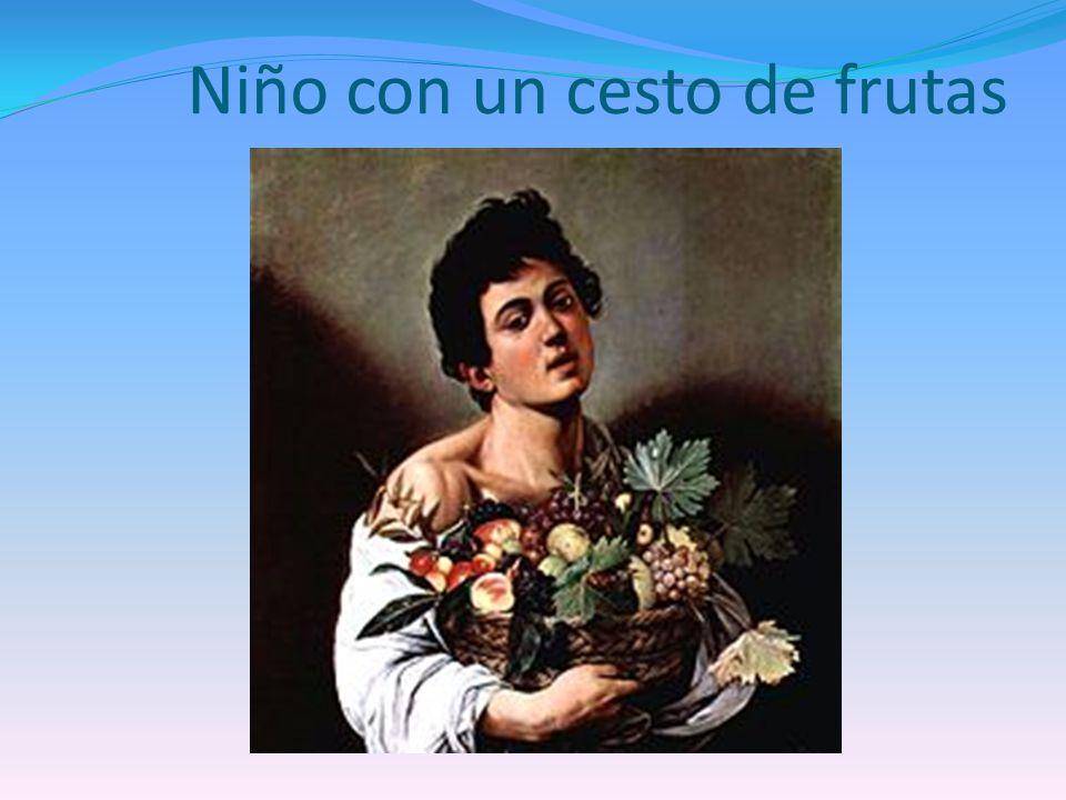 Niño con un cesto de frutas