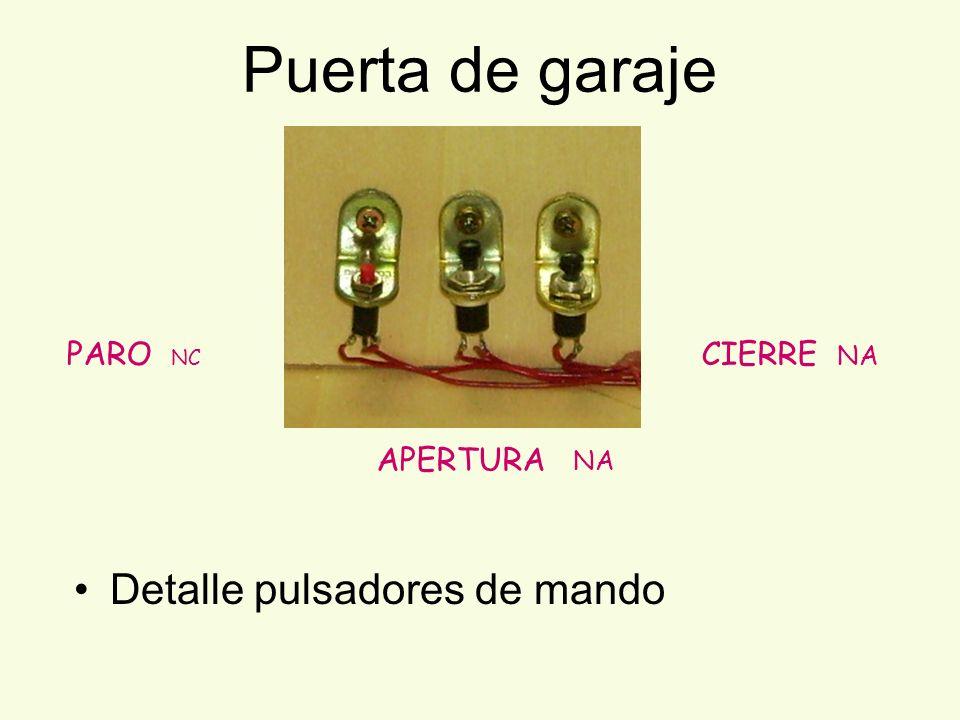 Puerta de garaje Detalle pulsadores de mando PARO NC APERTURA NA CIERRE NA