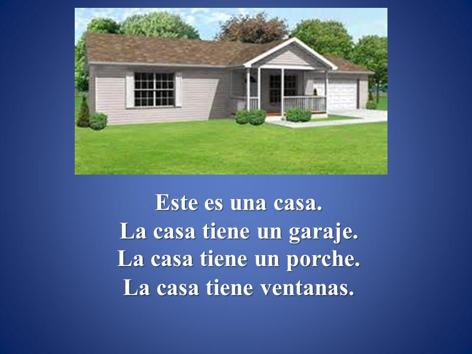 Este es una casa. La casa tiene un garaje. La casa tiene un porche. La casa tiene ventanas.