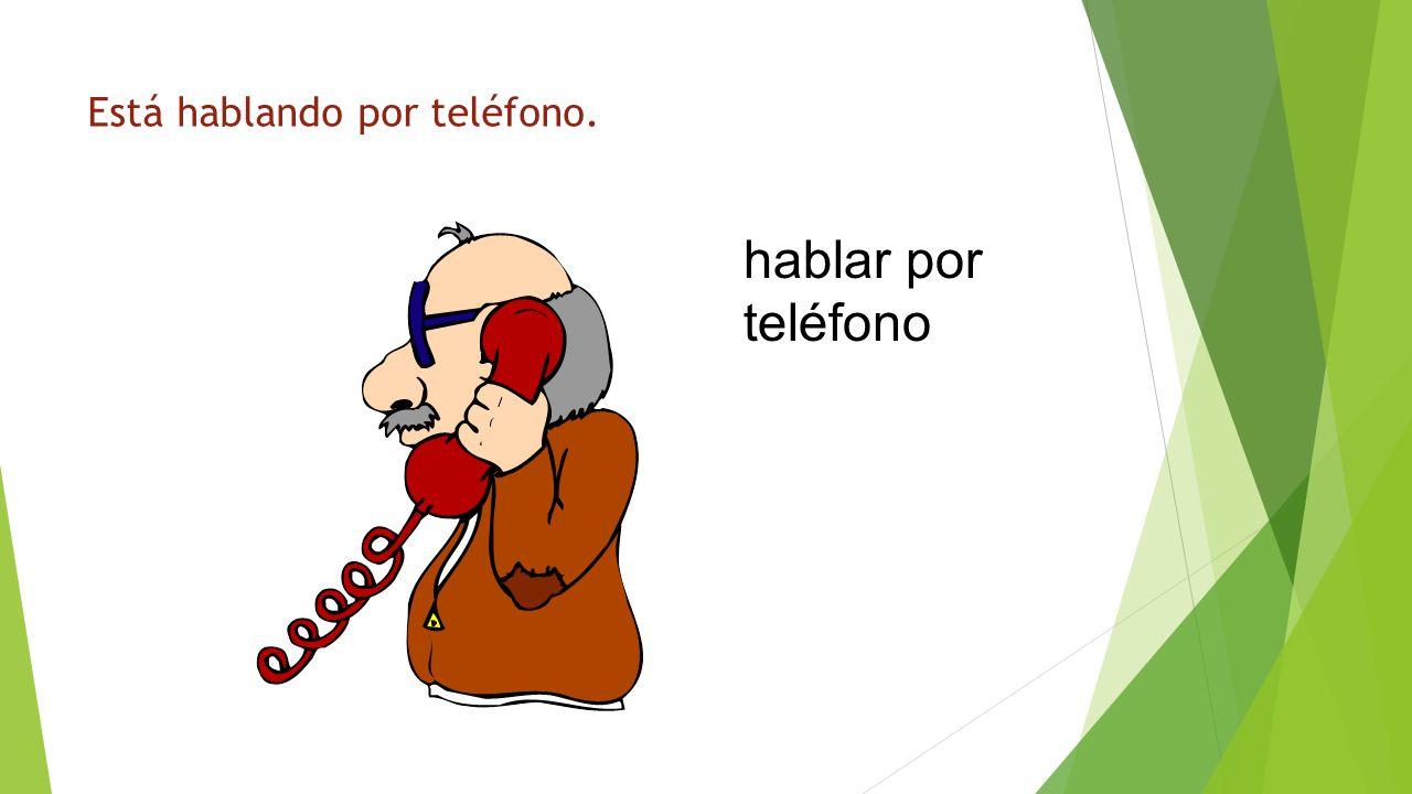 ¿Qué está haciendo? hablar por teléfono Está hablando por teléfono.