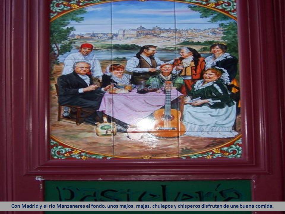 Unos chulapos disfrutan de la pradera de San Isidro. Al fondo, la ermita del Santo. Las antiguas tabernas de Madrid solían pintarse de rojo burdeos pa
