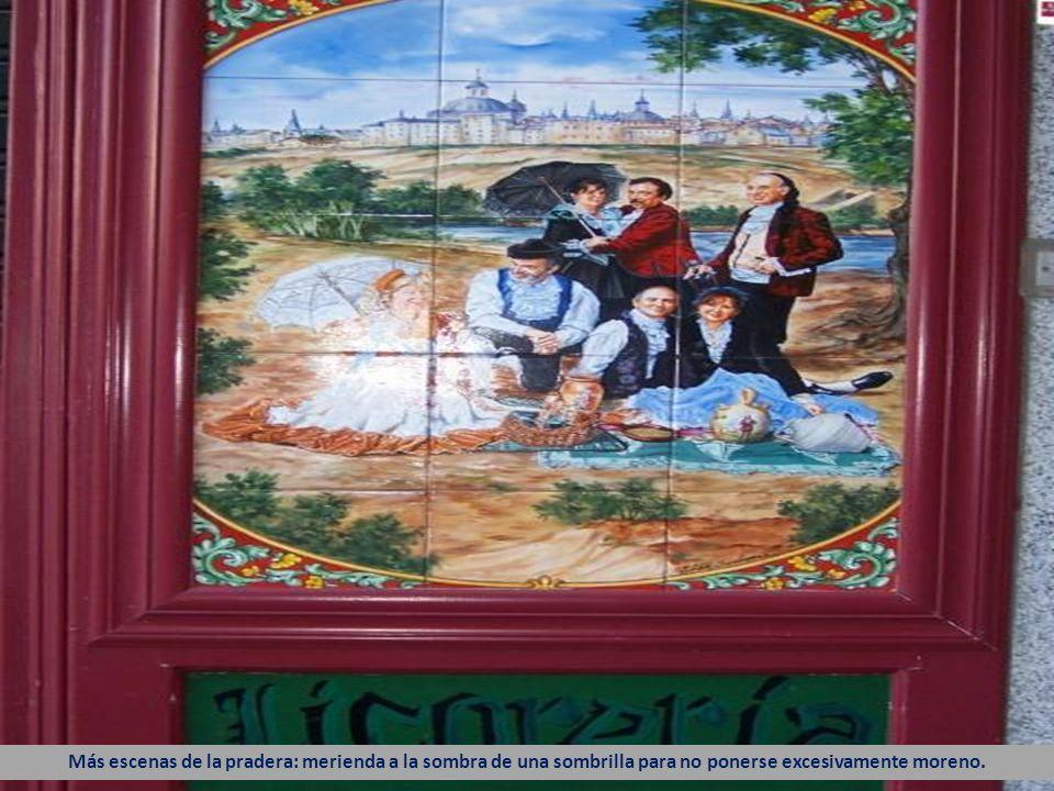 Con Madrid y el río Manzanares al fondo, unos majos, majas, chulapos y chisperos disfrutan de una buena comida.
