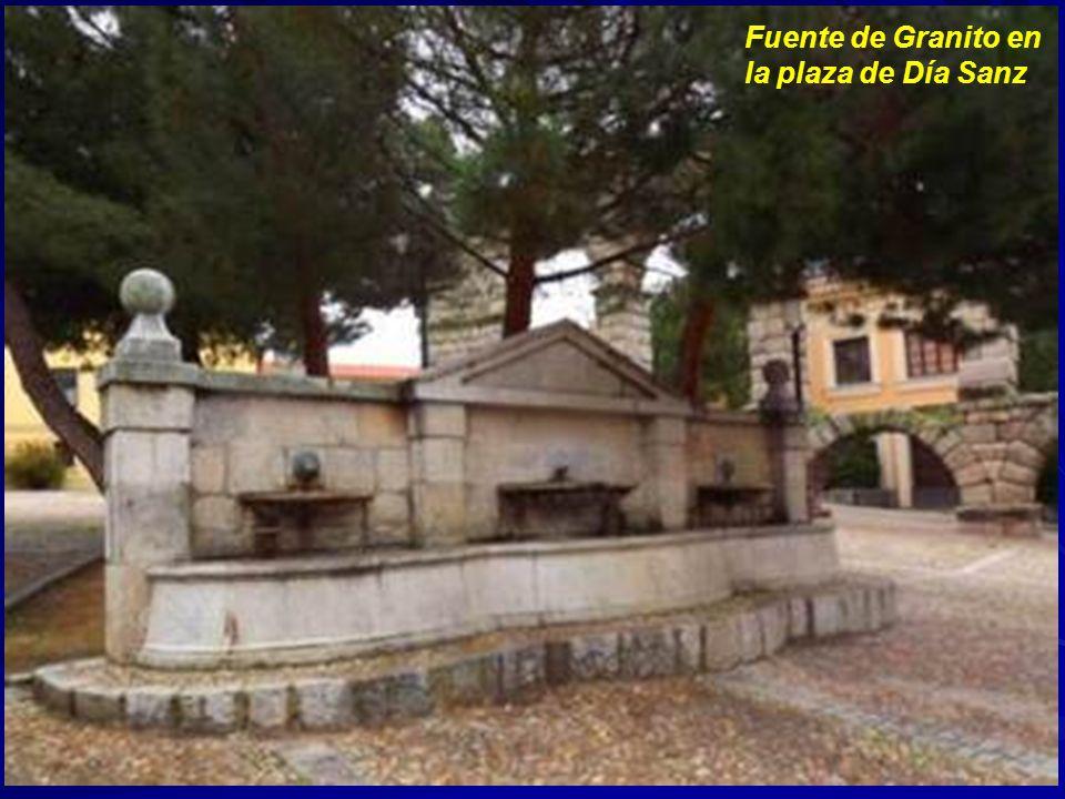 Foto del antiguo mercado de abastos de Muerte y Vida con la vieja fuente del reloj al fondo (Hoy plaza del Somorrostro)
