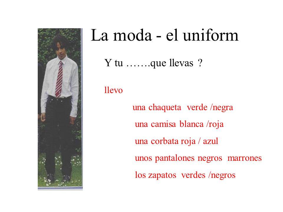 La moda - el uniform llevo una chaqueta verde /negra una camisa blanca /roja una corbata roja / azul unos pantalones negros marrones los zapatos verde