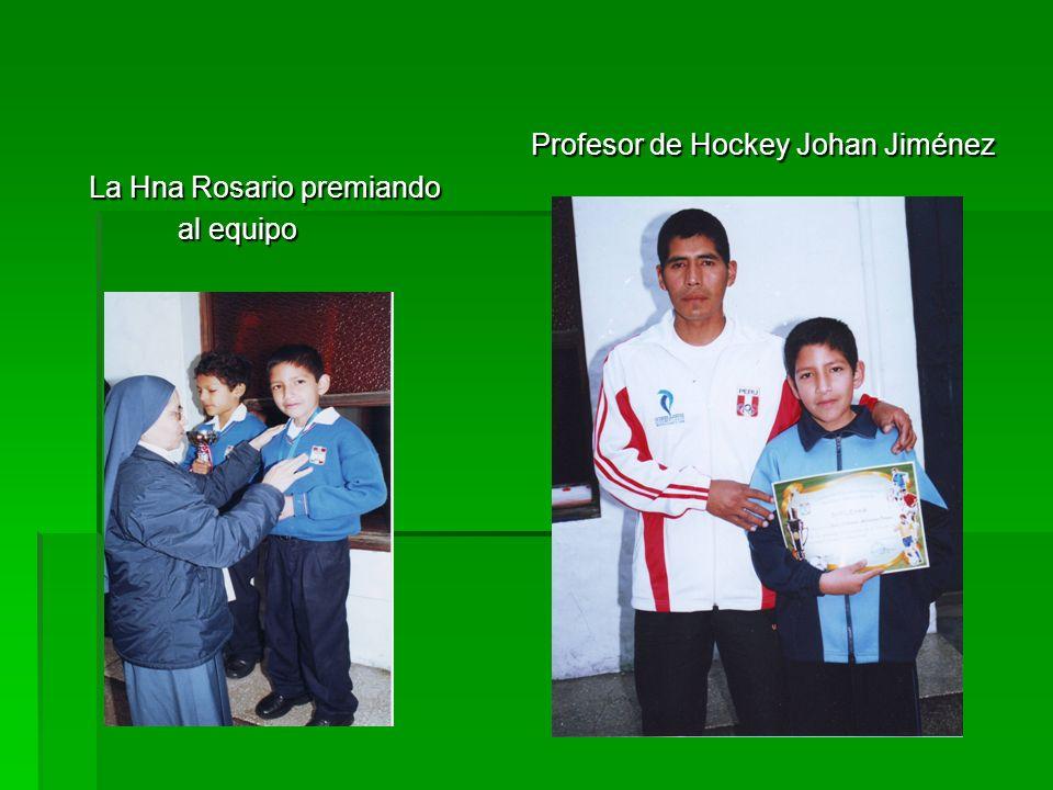 Profesor de Hockey Johan Jiménez Profesor de Hockey Johan Jiménez La Hna Rosario premiando al equipo al equipo