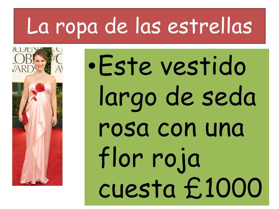 La ropa de las estrellas Este vestido largo de seda rosa con una flor roja cuesta £1000