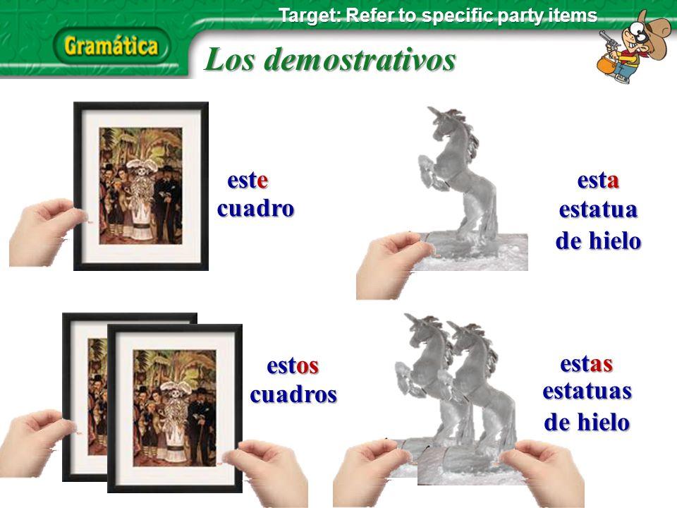 Los demostrativos cuadro cuadros estatua estatua de hielo de hielo estatuas de hielo este esta estos estas Target: Refer to specific party items