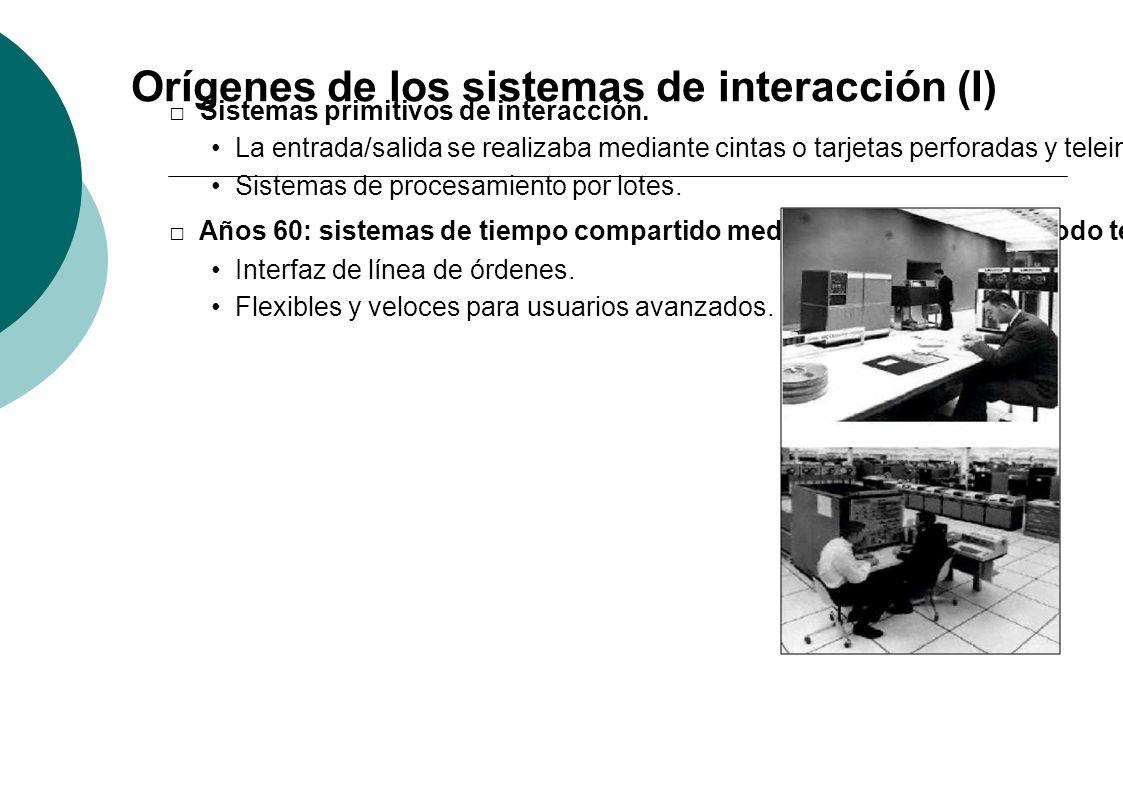 Orígenes de los sistemas de interacción (I) Sistemas primitivos de interacción. La entrada/salida se realizaba mediante cintas o tarjetas perforadas y