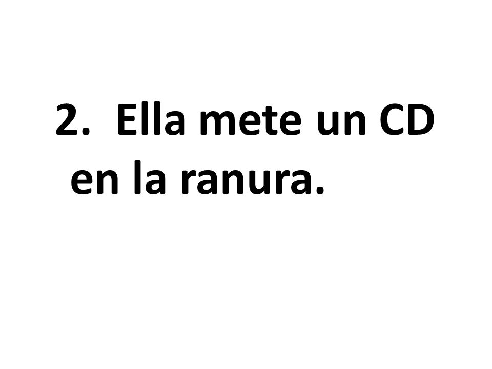 She inserts a CD in the disk drive.