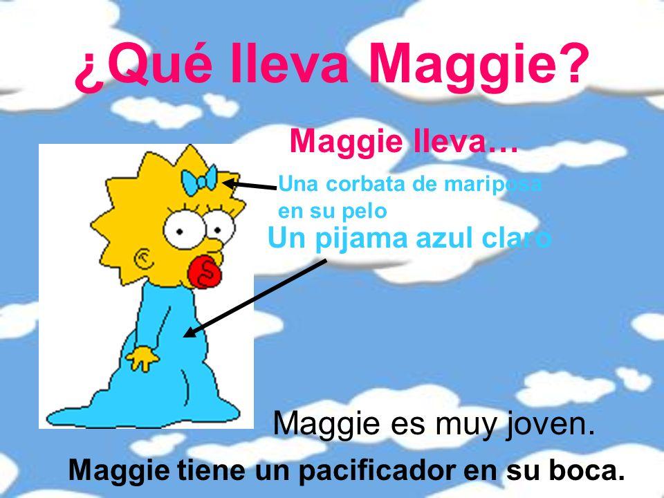 ¿Qué lleva Maggie.Maggie lleva… Un pijama azul claro Maggie tiene un pacificador en su boca.