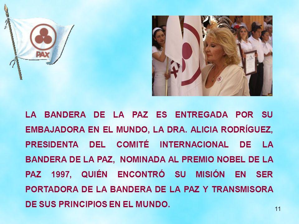 11 LA BANDERA DE LA PAZ ES ENTREGADA POR SU EMBAJADORA EN EL MUNDO, LA DRA. ALICIA RODRÍGUEZ, PRESIDENTA DEL COMITÉ INTERNACIONAL DE LA BANDERA DE LA