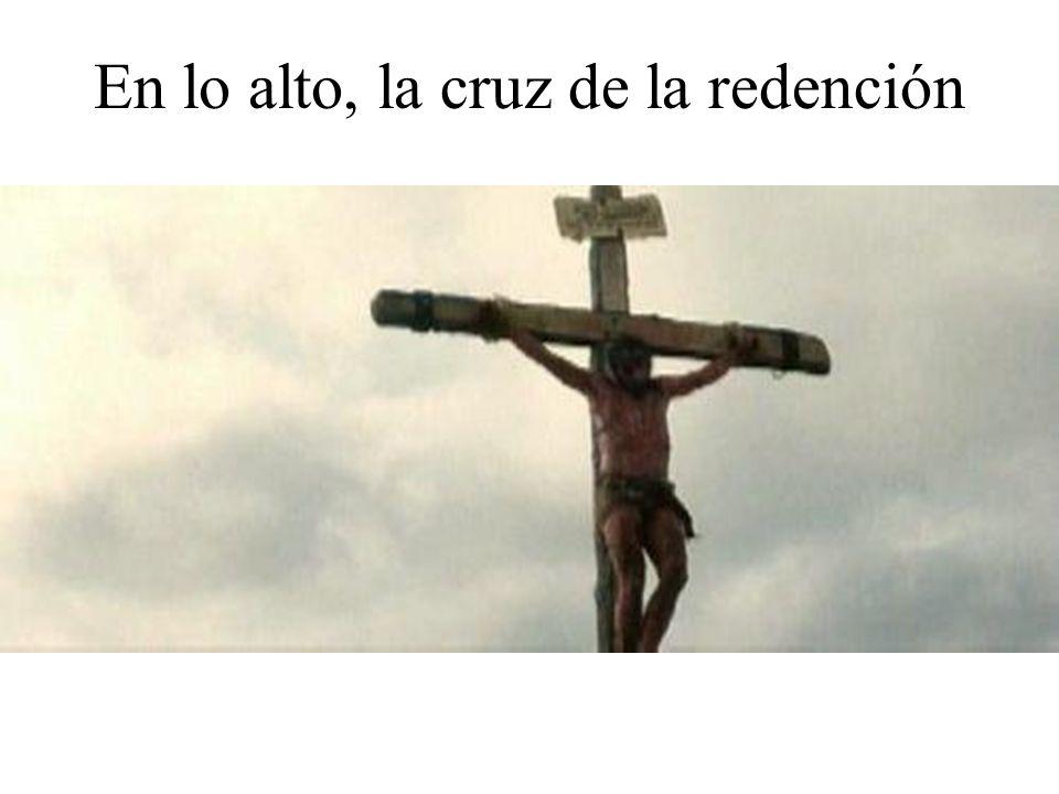 En lo alto, la cruz de la redención
