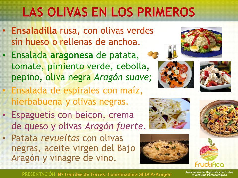 Ensaladilla rusa, con olivas verdes sin hueso o rellenas de anchoa. Ensalada aragonesa de patata, tomate, pimiento verde, cebolla, pepino, oliva negra