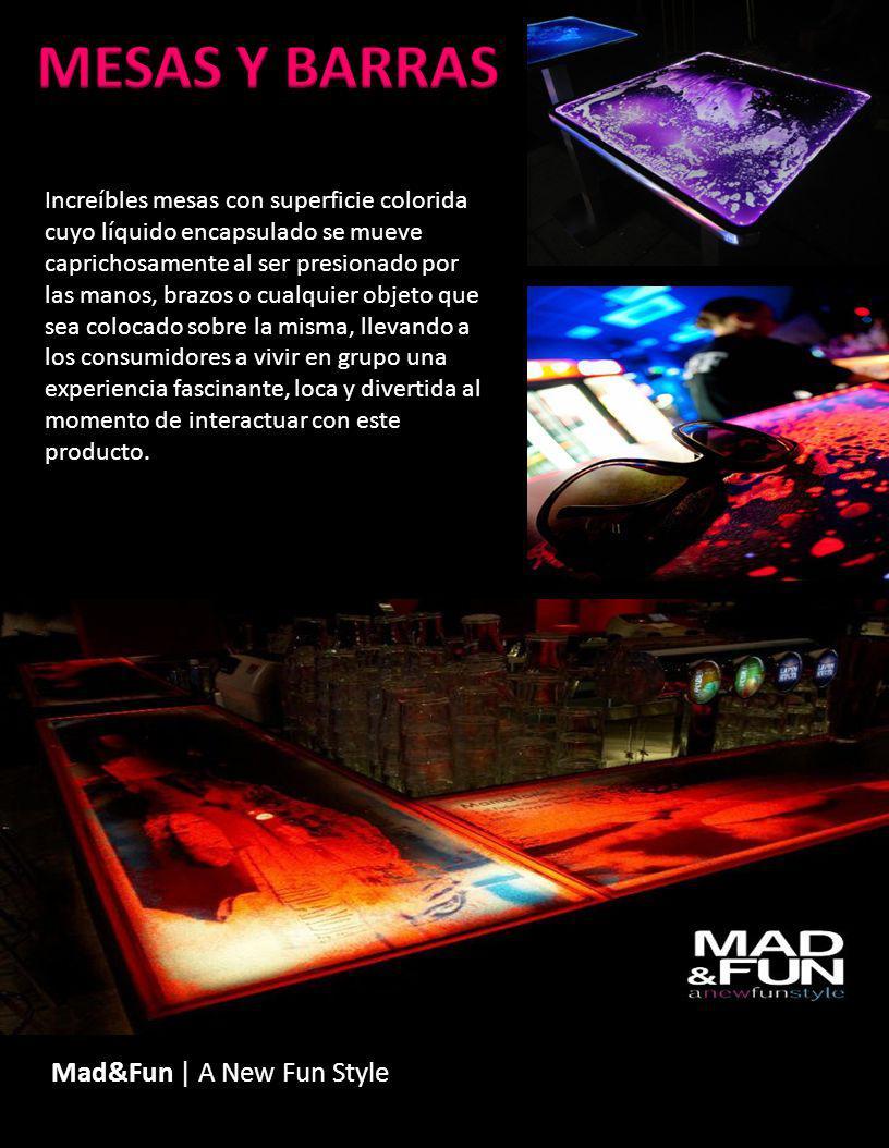 Mad&Fun | A New Fun Style Increíbles mesas con superficie colorida cuyo líquido encapsulado se mueve caprichosamente al ser presionado por las manos,