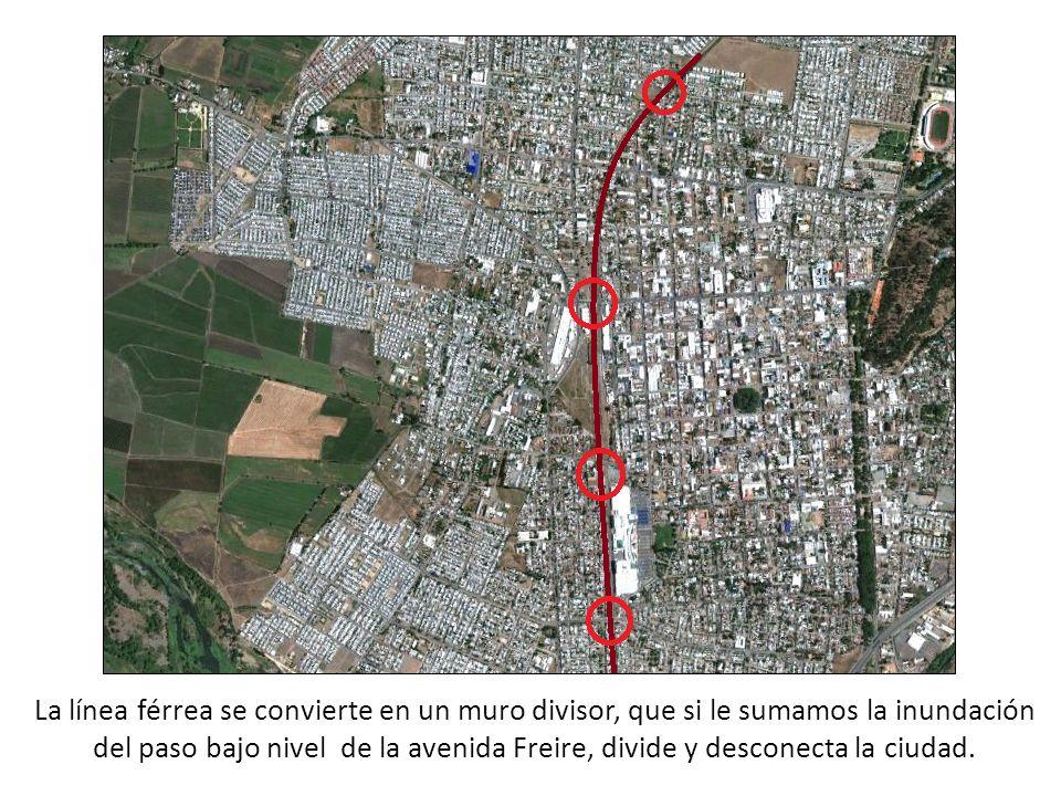 La línea férrea se convierte en un muro divisor, que si le sumamos la inundación del paso bajo nivel de la avenida Freire, divide y desconecta la ciud