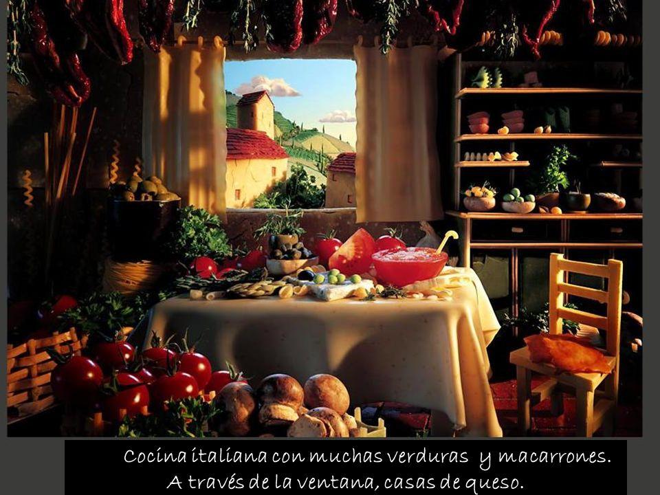 Cocina italiana con muchas verduras y macarrones. A través de la ventana, casas de queso.