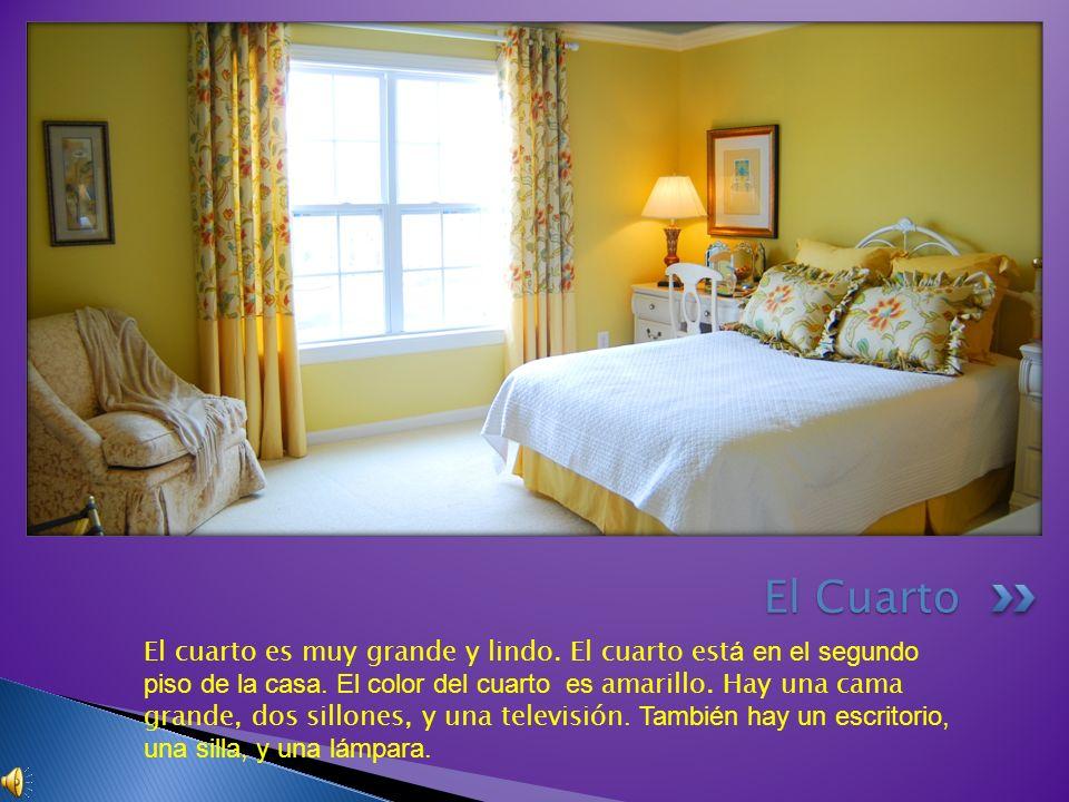 El cuarto es muy grande y lindo. El cuarto est á en el segundo piso de la casa. El color del cuarto es amarillo. Hay una cama grande, dos sillones, y