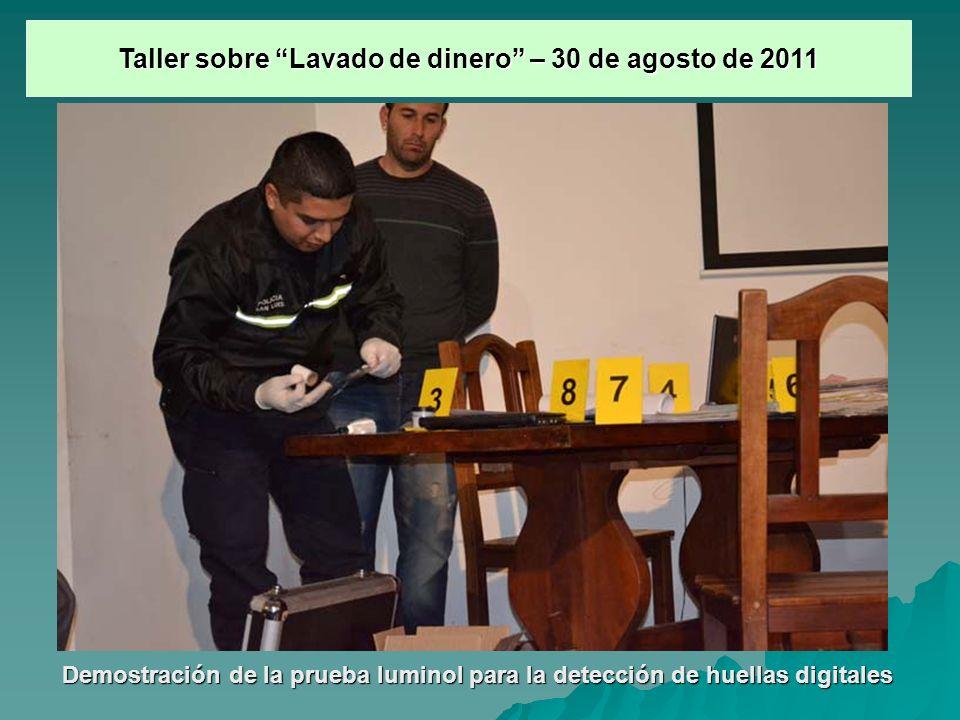 Demostración de la prueba luminol para la detección de huellas digitales Taller sobre Lavado de dinero – 30 de agosto de 2011