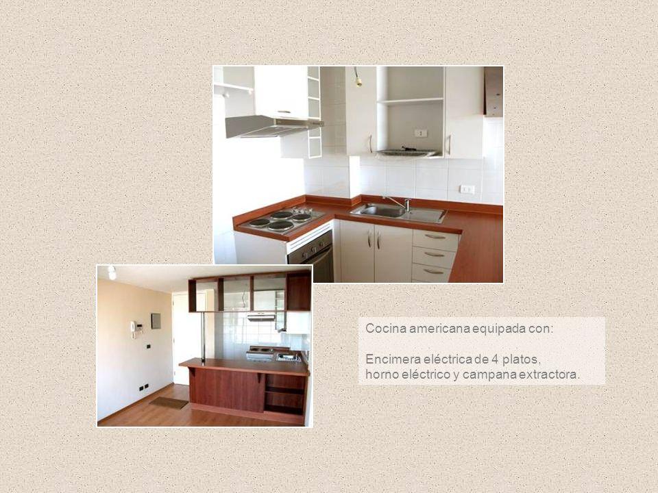 Cocina americana equipada con: Encimera eléctrica de 4 platos, horno eléctrico y campana extractora.