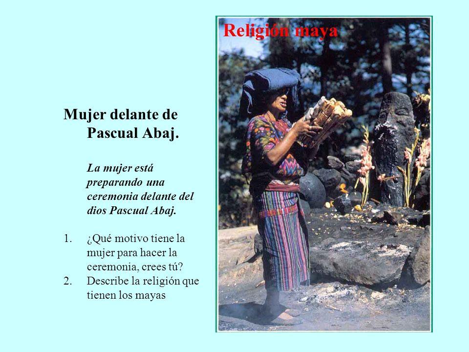 Mujer delante de Pascual Abaj. La mujer está preparando una ceremonia delante del dios Pascual Abaj. 1.¿Qué motivo tiene la mujer para hacer la ceremo