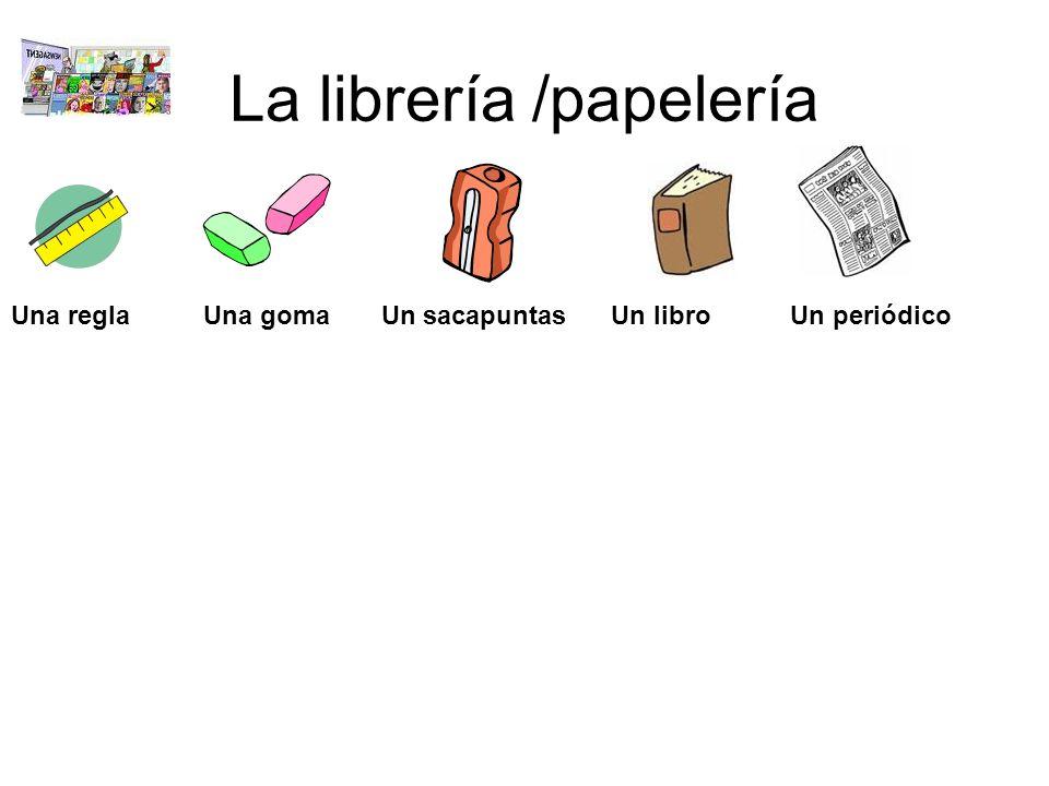 La librería /papelería Una regla Una goma Un sacapuntas Un libro Un periódico