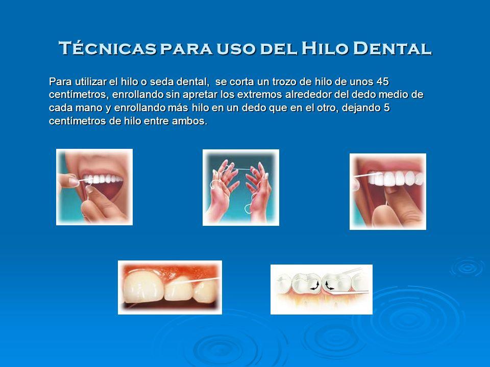 Técnicas para uso del Hilo Dental Para utilizar el hilo o seda dental, se corta un trozo de hilo de unos 45 centímetros, enrollando sin apretar los ex