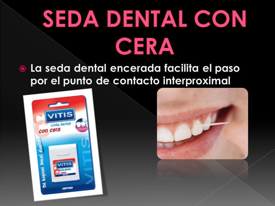 La seda dental encerada facilita el paso por el punto de contacto interproximal