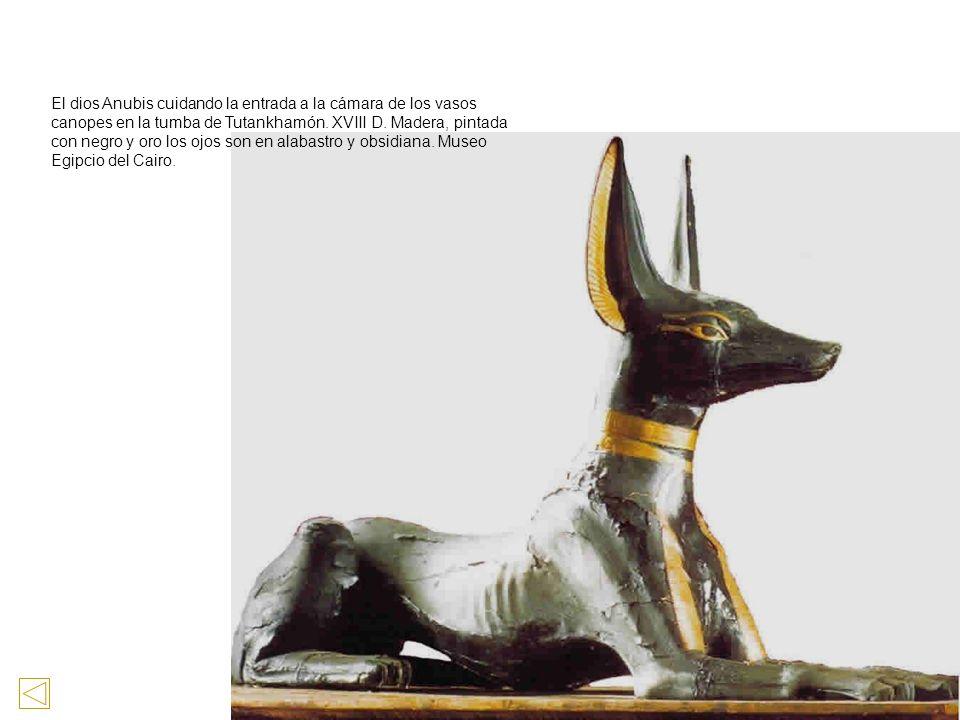 El dios Anubis cuidando la entrada a la cámara de los vasos canopes en la tumba de Tutankhamón.
