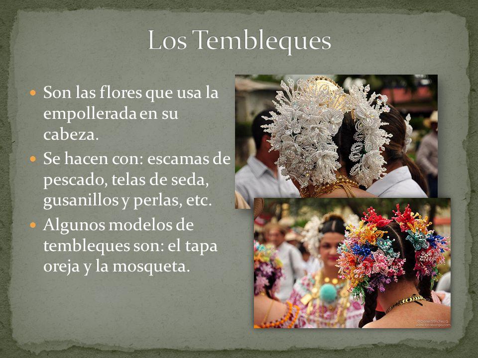 Son las flores que usa la empollerada en su cabeza. Se hacen con: escamas de pescado, telas de seda, gusanillos y perlas, etc. Algunos modelos de temb